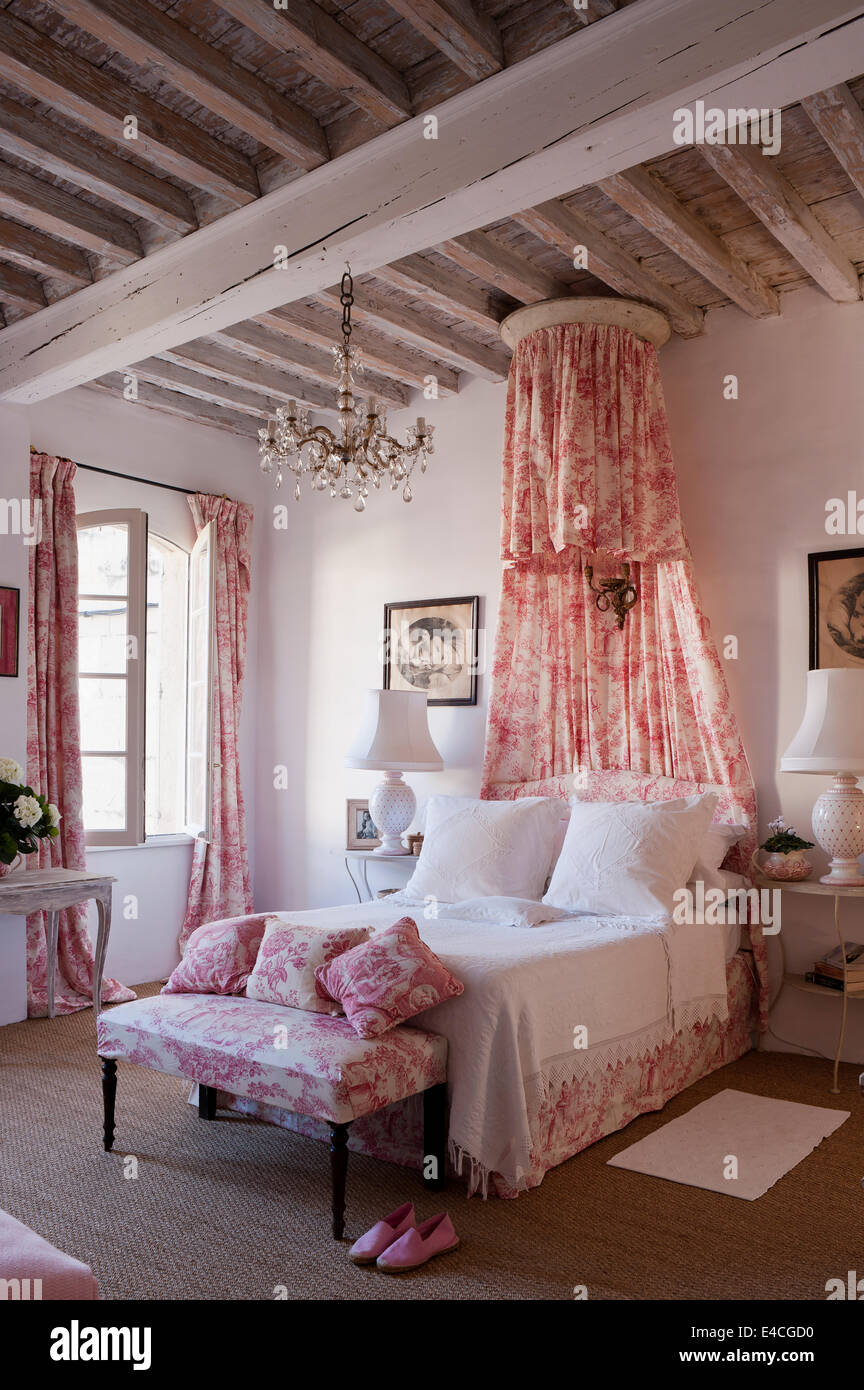 pink and white toile de jouy fabric on cushions, curtain and bed