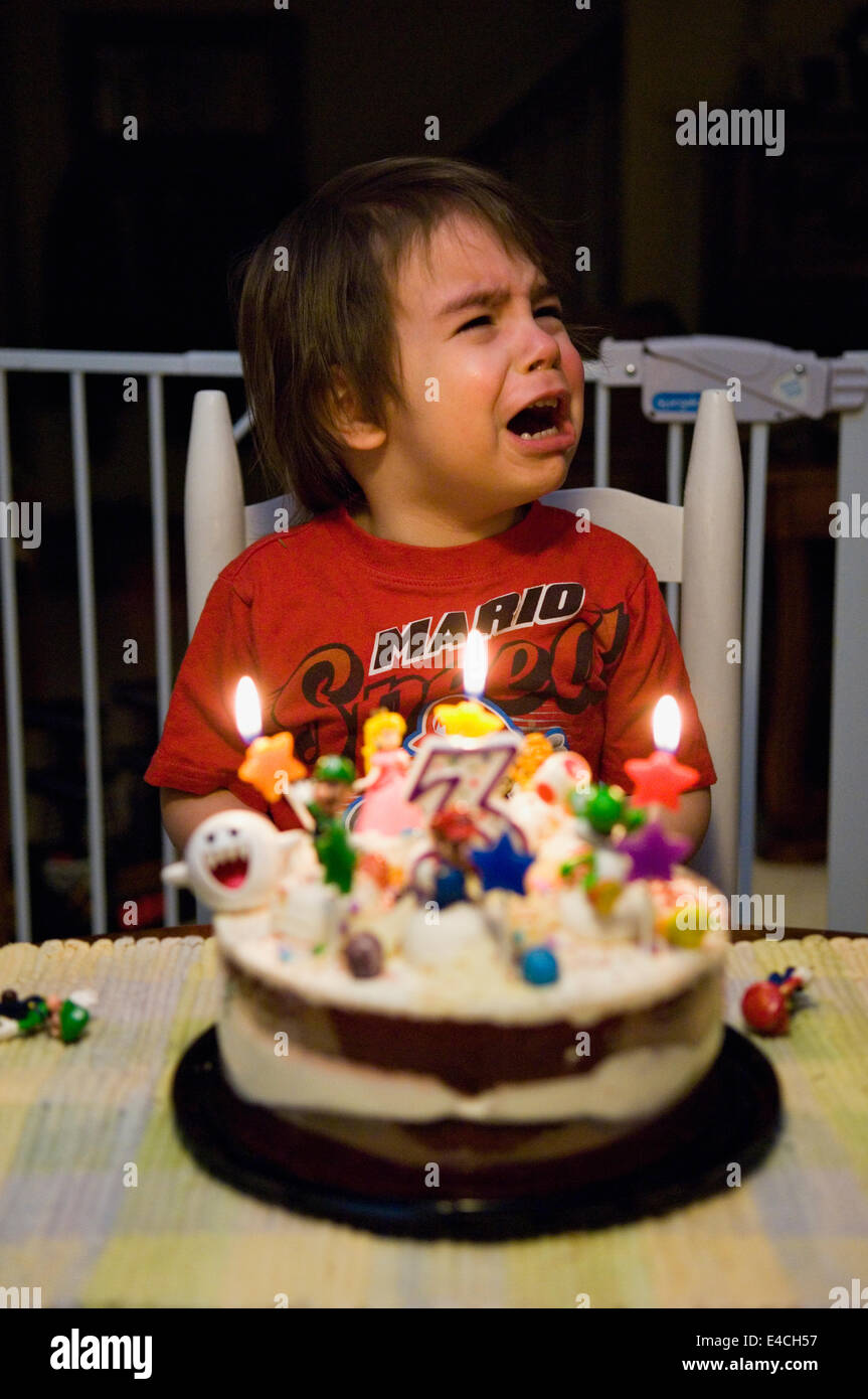 Three Year Old Boy Crying While Celebrating his Birthday Stock