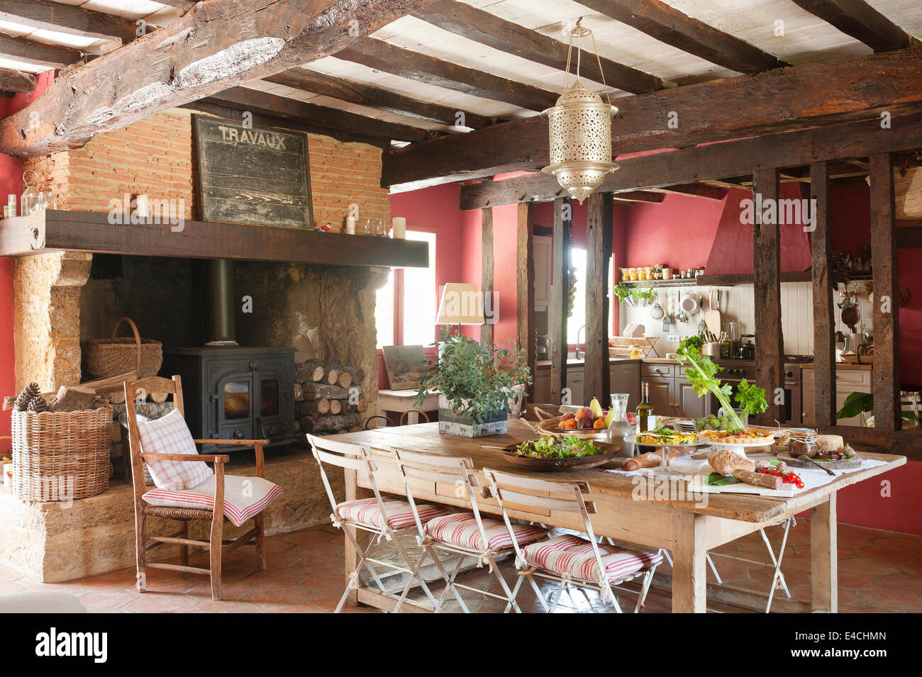Rustic french country kitchens - Large Rustic French Country Kitchen With Old Ceiling Beams Woodburning Stove And Laid Table
