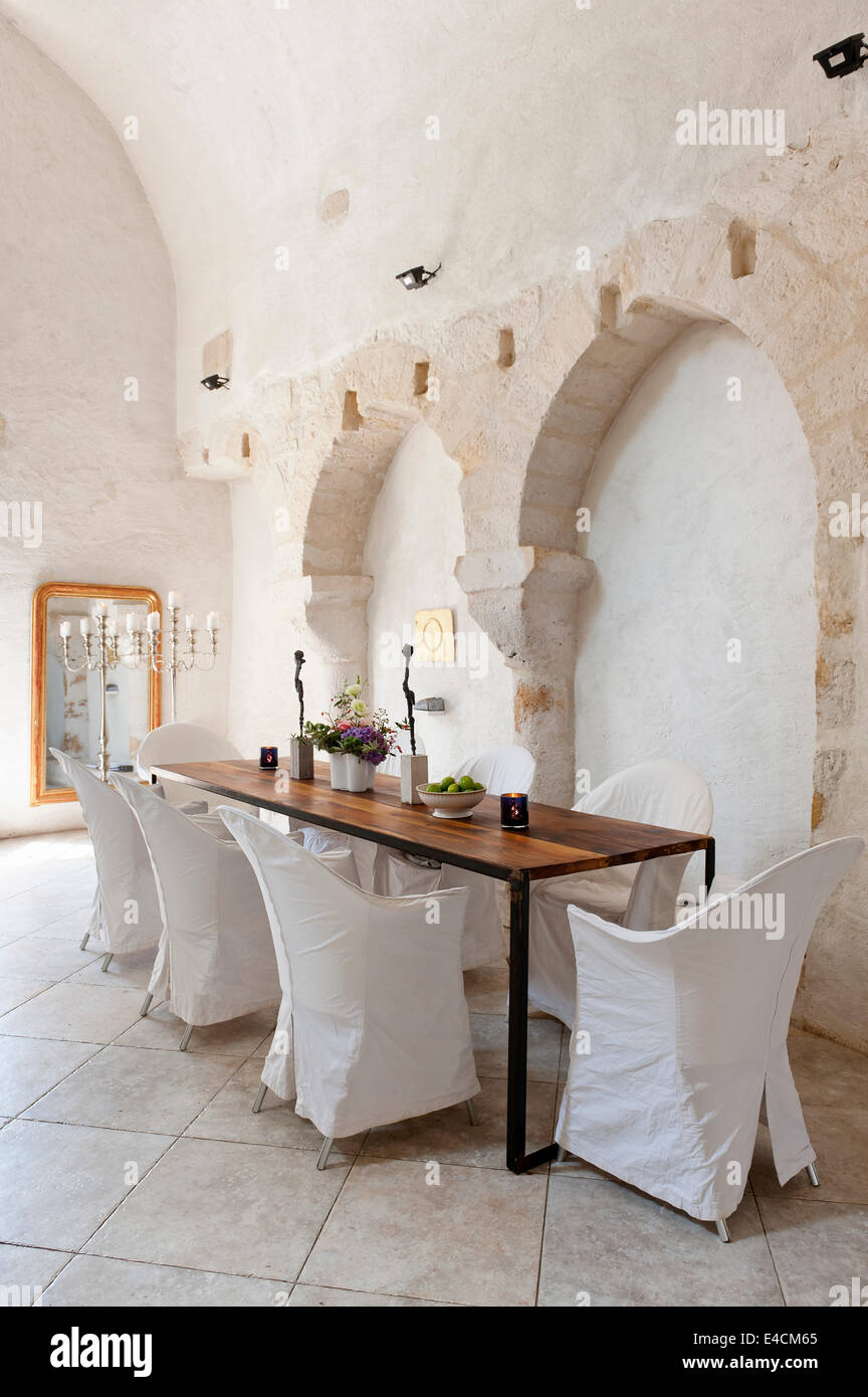 dining room in converted french chapel the floor is limestone and dining room in converted french chapel the floor is limestone and the table designed by joris von grinsven