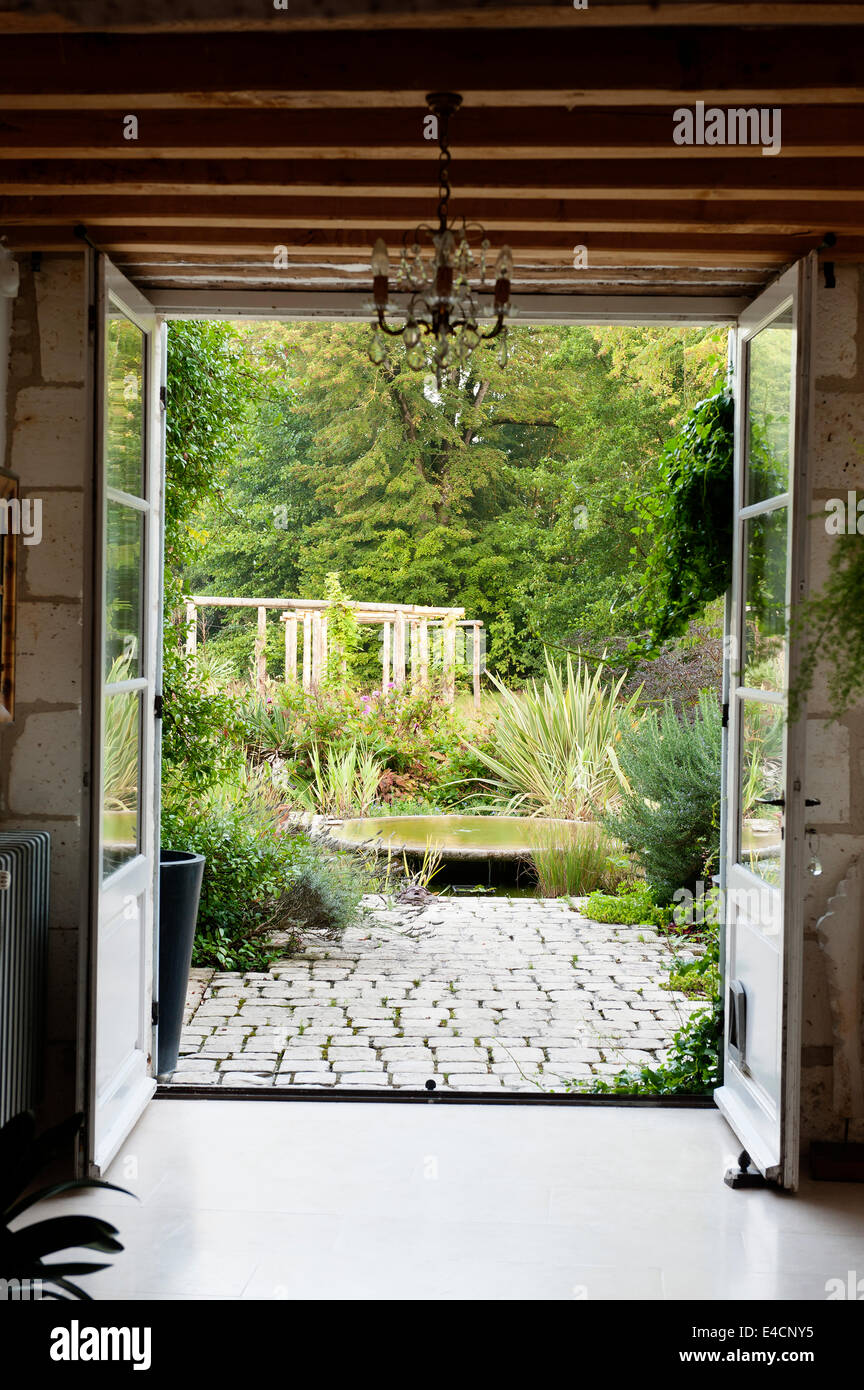 View Through French Windows Out On To Cobbled Patio And