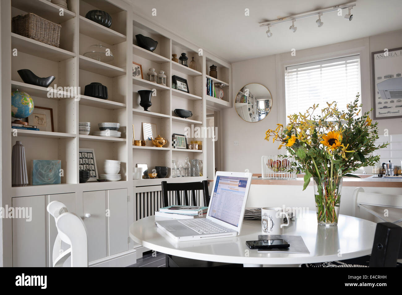 Laptop On White Ikea Table In Open Plan Kitchen And Diner