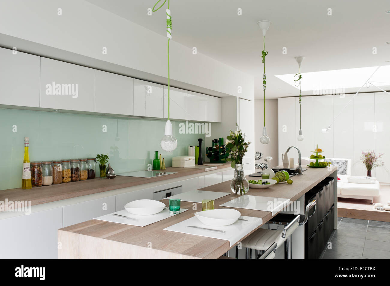 Küchen modern  Modern kitchen from Beeck kuechen. The green corded pendant lights ...