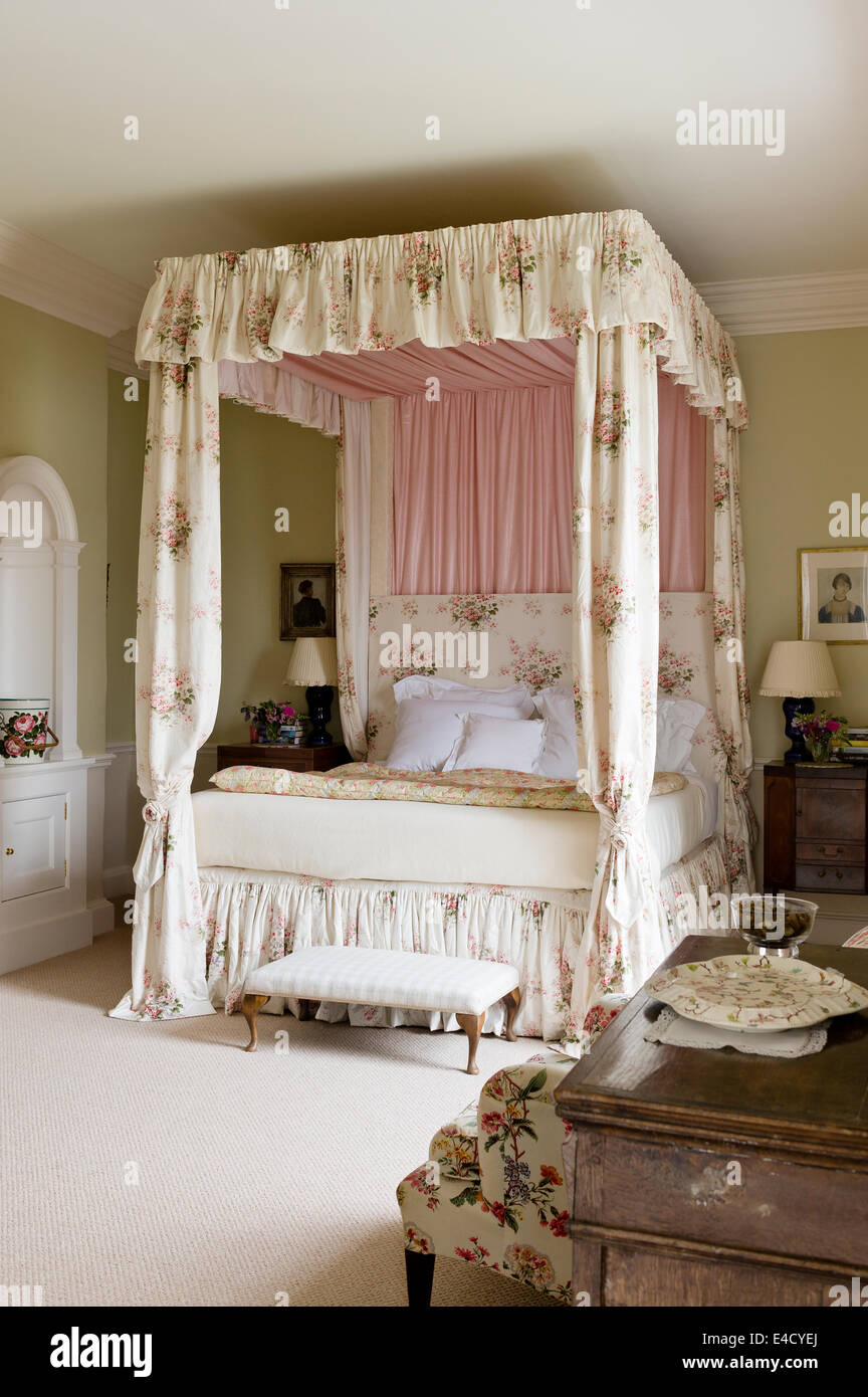 fourposter bed with chintz curtains in olive green bedroom. paint