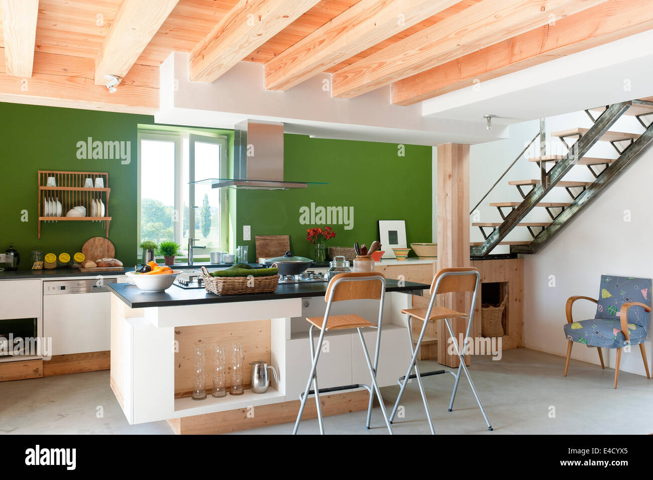 Bright Spacious Kitchen In New Extension With Wooden Ceiling Beams Folding Bar Stools And Island
