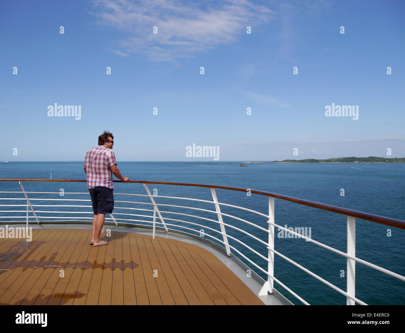 A Cruise Ship Passenger Looking Out To Sea From The Top Deck Stock Photo Royalty Free Image ...