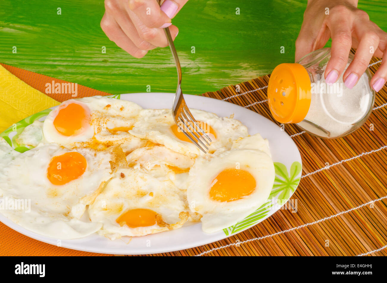 Heftily Salting Fried Eggs, An Unhealthy Nutrition Concept Stock ...