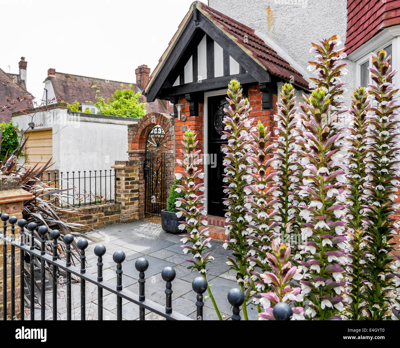 english home with tudor style gable stone slabs and acanthus