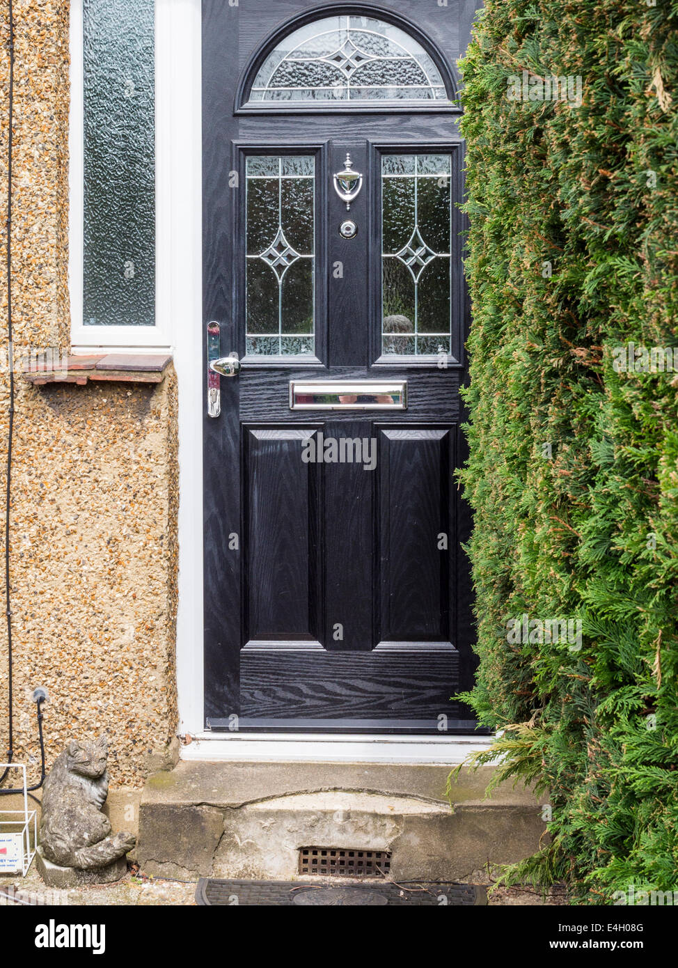 House entrance black front door with decorative glass panel and house entrance black front door with decorative glass panel and stone cat ornament in twickenham greater london uk rubansaba