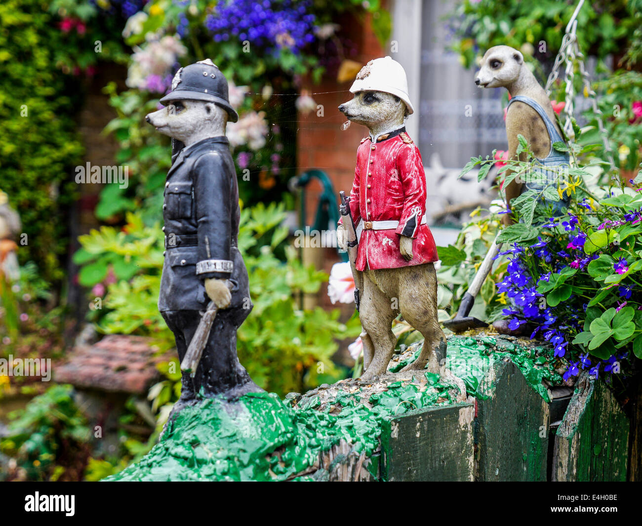 Meerkat ornaments policeman and fireman on a wall in a for Quirky ornaments uk