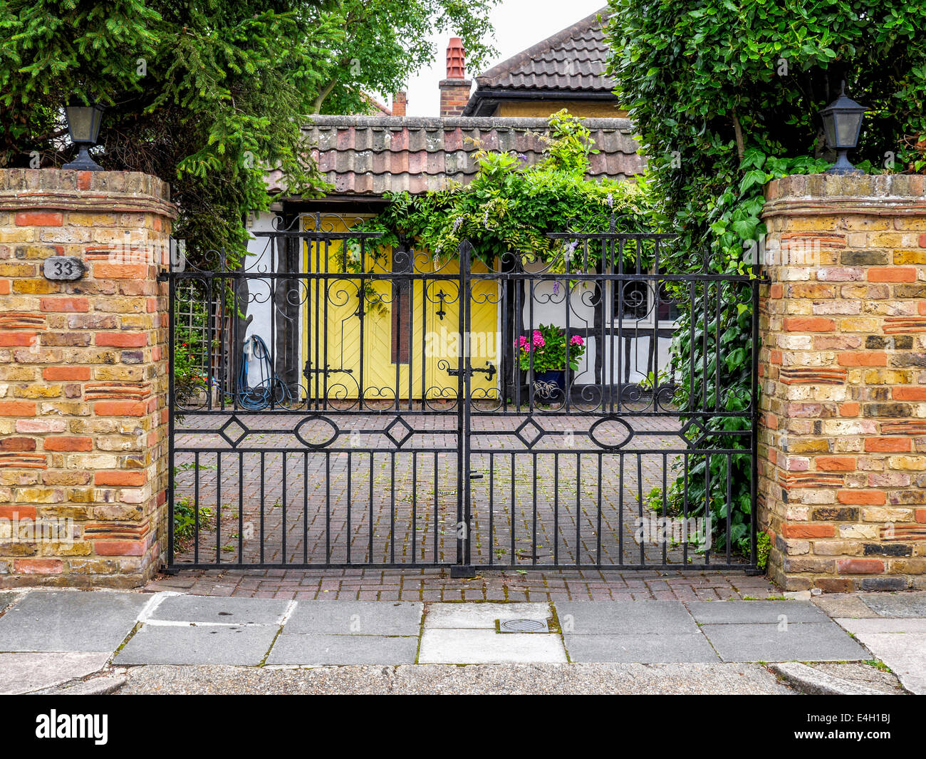 Decorative wrought iron gate and brick wall of twickenham for Brick and wrought iron fence