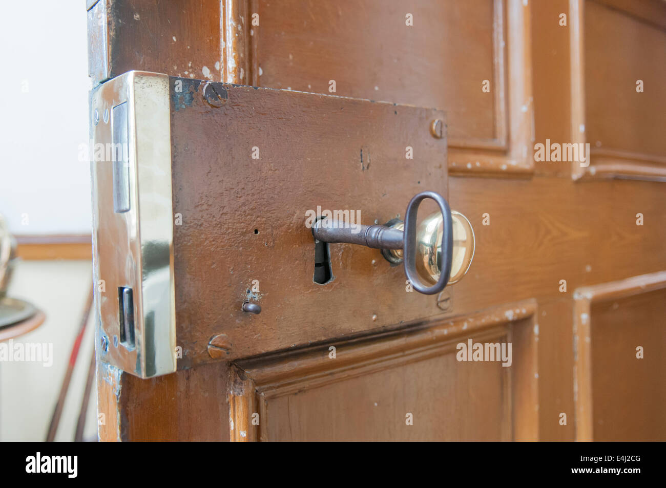 Heavy brass lock on the inside of a door with a large old - Old fashioned interior door locks ...