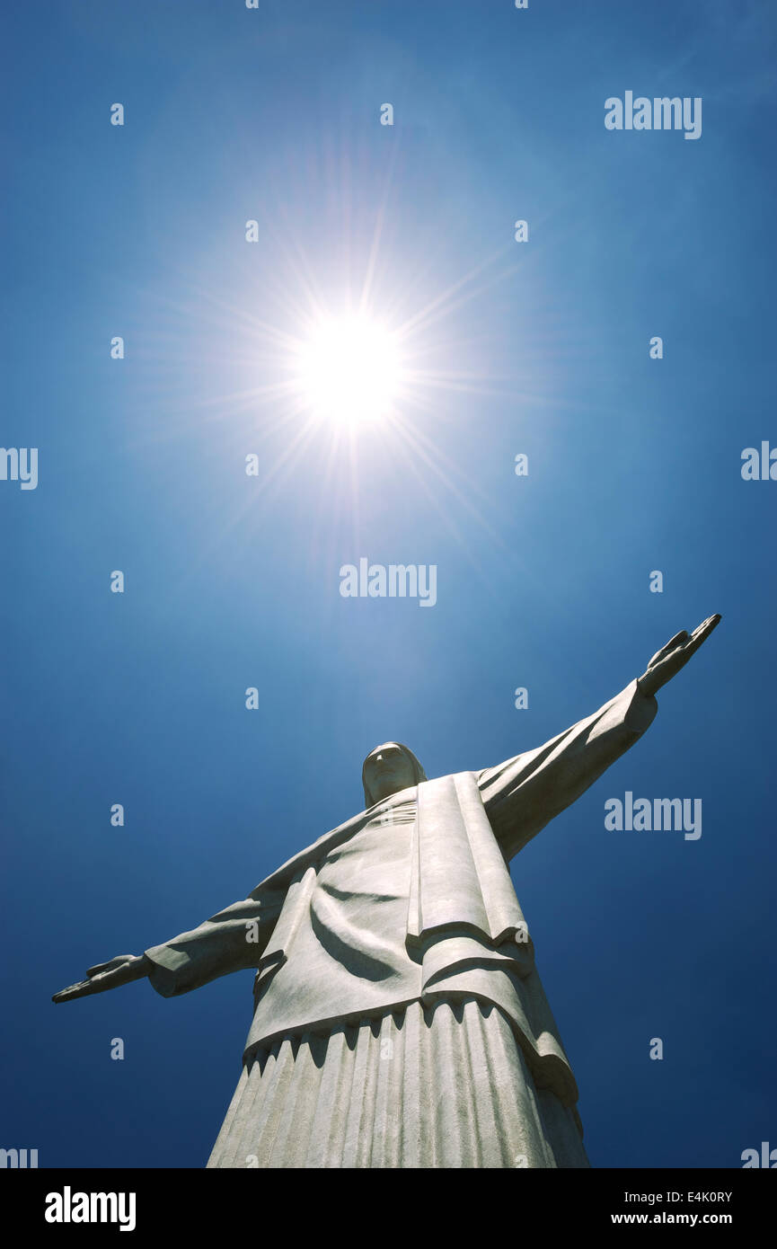 Statue of christ the redeemer a symbol of rio stands at the peak statue of christ the redeemer a symbol of rio stands at the peak of corcovado mountain under bright tropical sun biocorpaavc