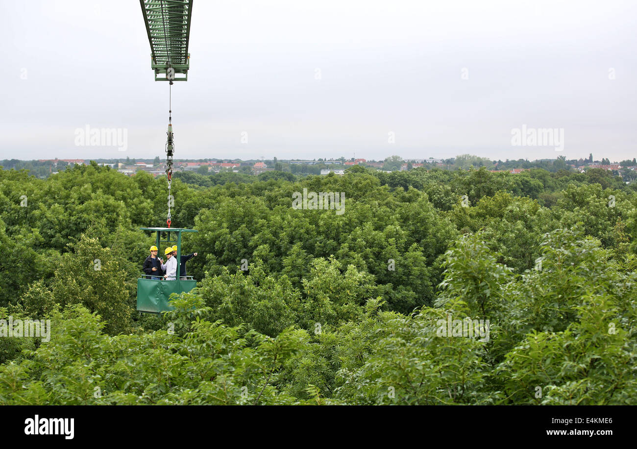 Scientists of Leipzig University travel in a small canopy crane across the Auwald near Leipzig Germany 9 July 2014. A year after the canopy crane was ... & Leipzig Germany. 9th July 2014. Scientists of Leipzig University ...