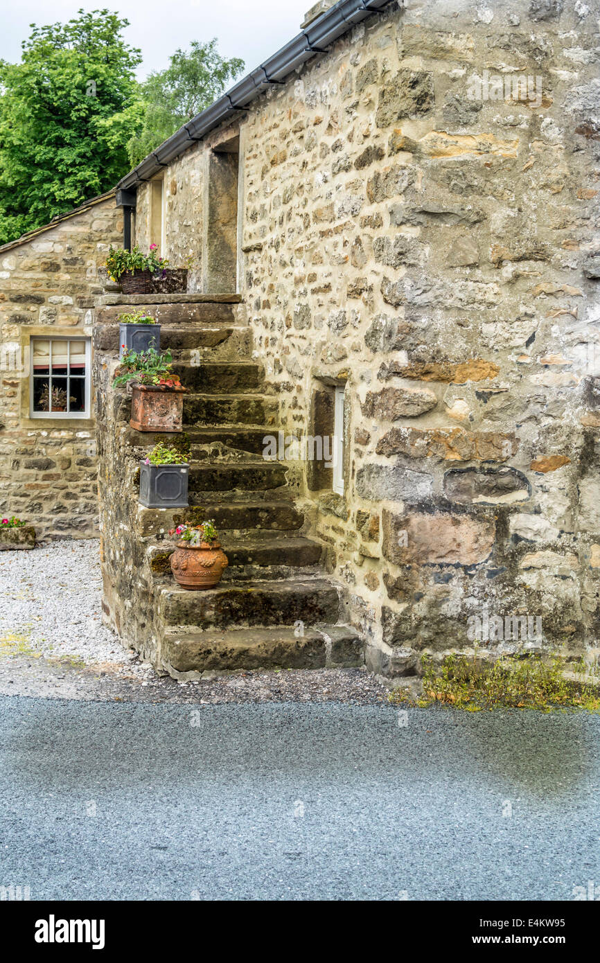 Stock Photo   Stone Steps Leading Up The Outside Of An Old Stone Built House
