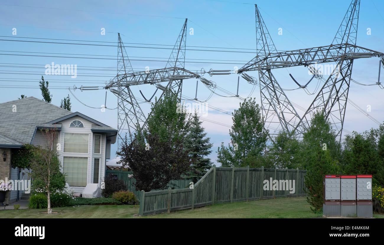a city house located very near power transmission lines