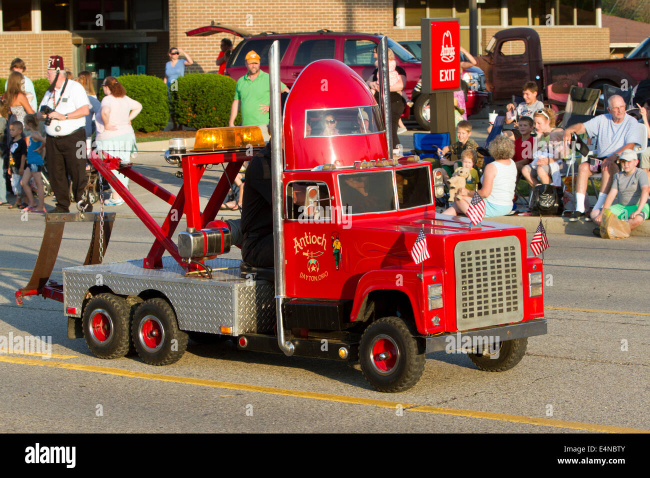 Miniature tow truck in a parade used by the shriners for their performances stock