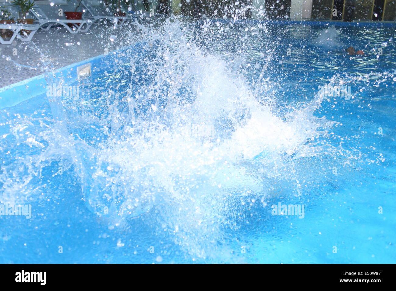pool water splash. big splash in pool water b