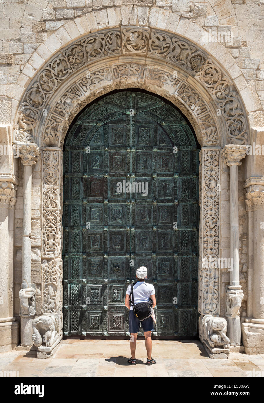 Stock Photo - The carved romanesque surround and bronze doors to The 12th century romanesque Cathedral at Trani Puglia Southern Italy & The carved romanesque surround and bronze doors to The 12th ... Pezcame.Com