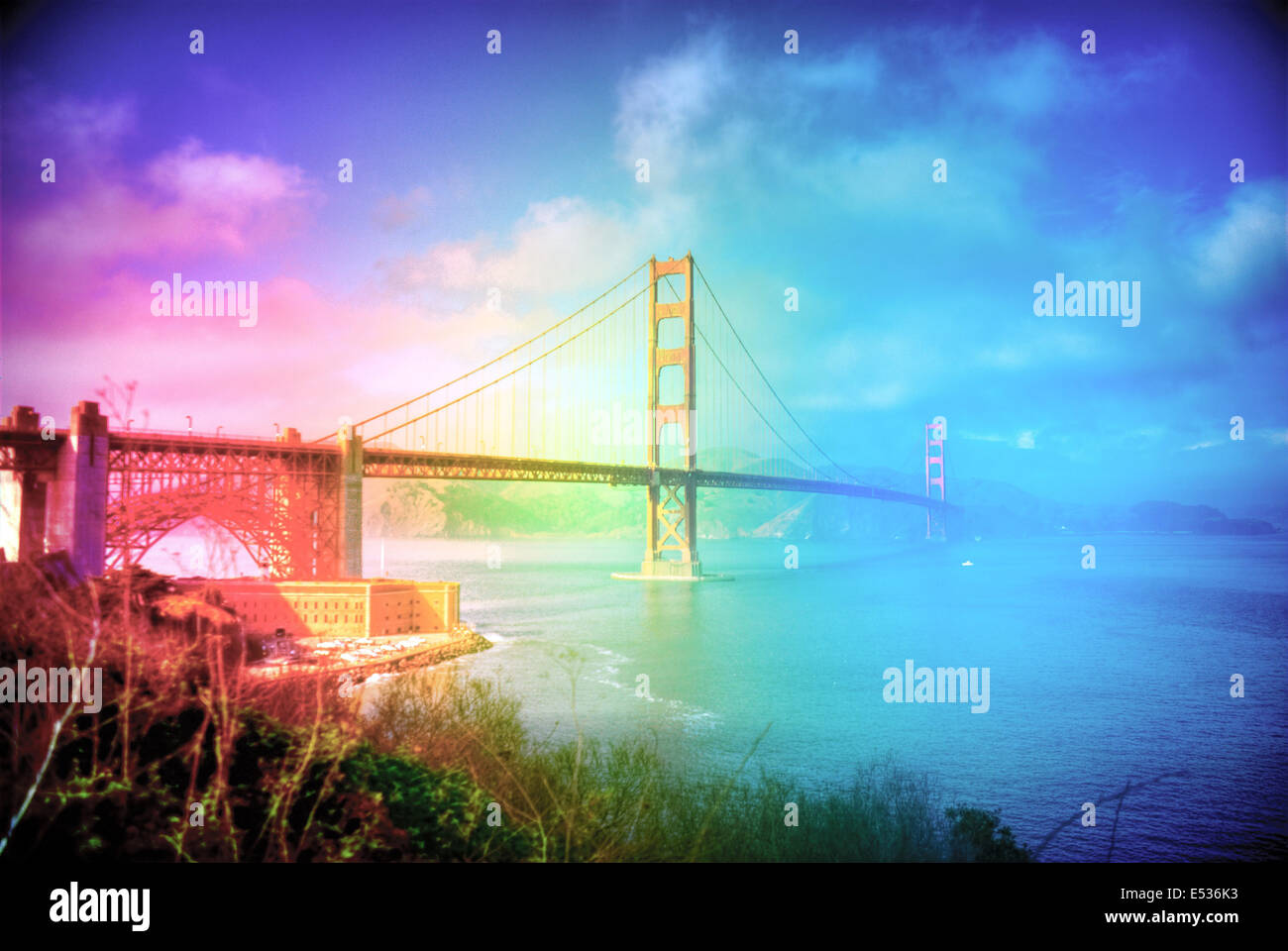 the golden gate bridge overlaid with a rainbow showing the open