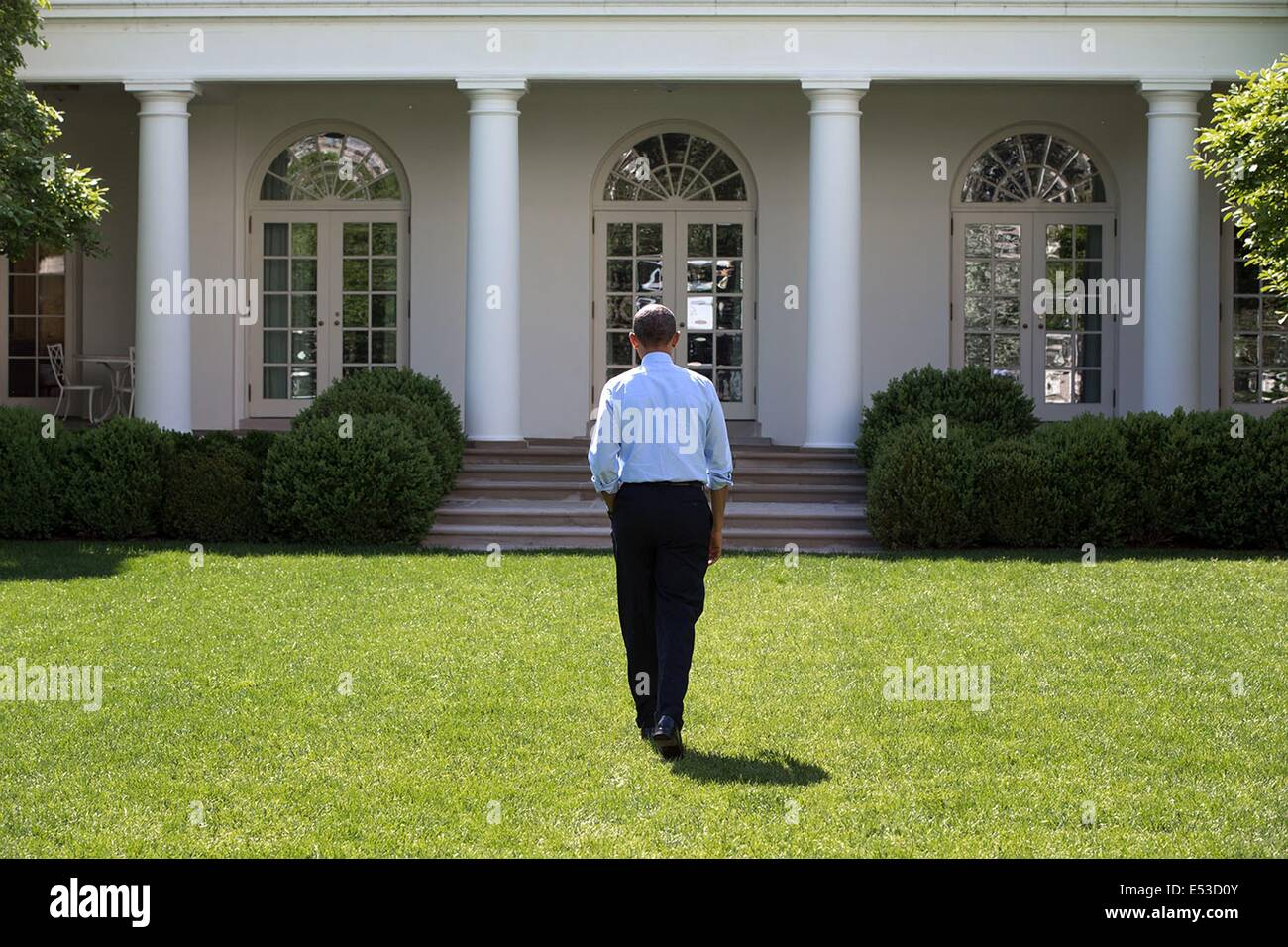 Us President Barack Obama Walks Alone Through The Rose Garden Of The Stock Photo Royalty Free