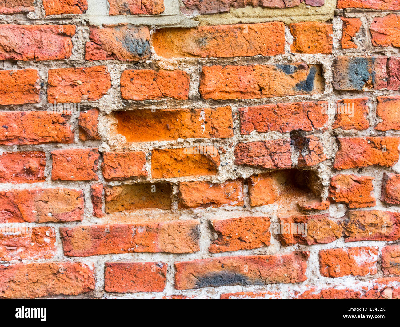 A Flemish Bond Red Brick Wall Severely Weather Damaged By
