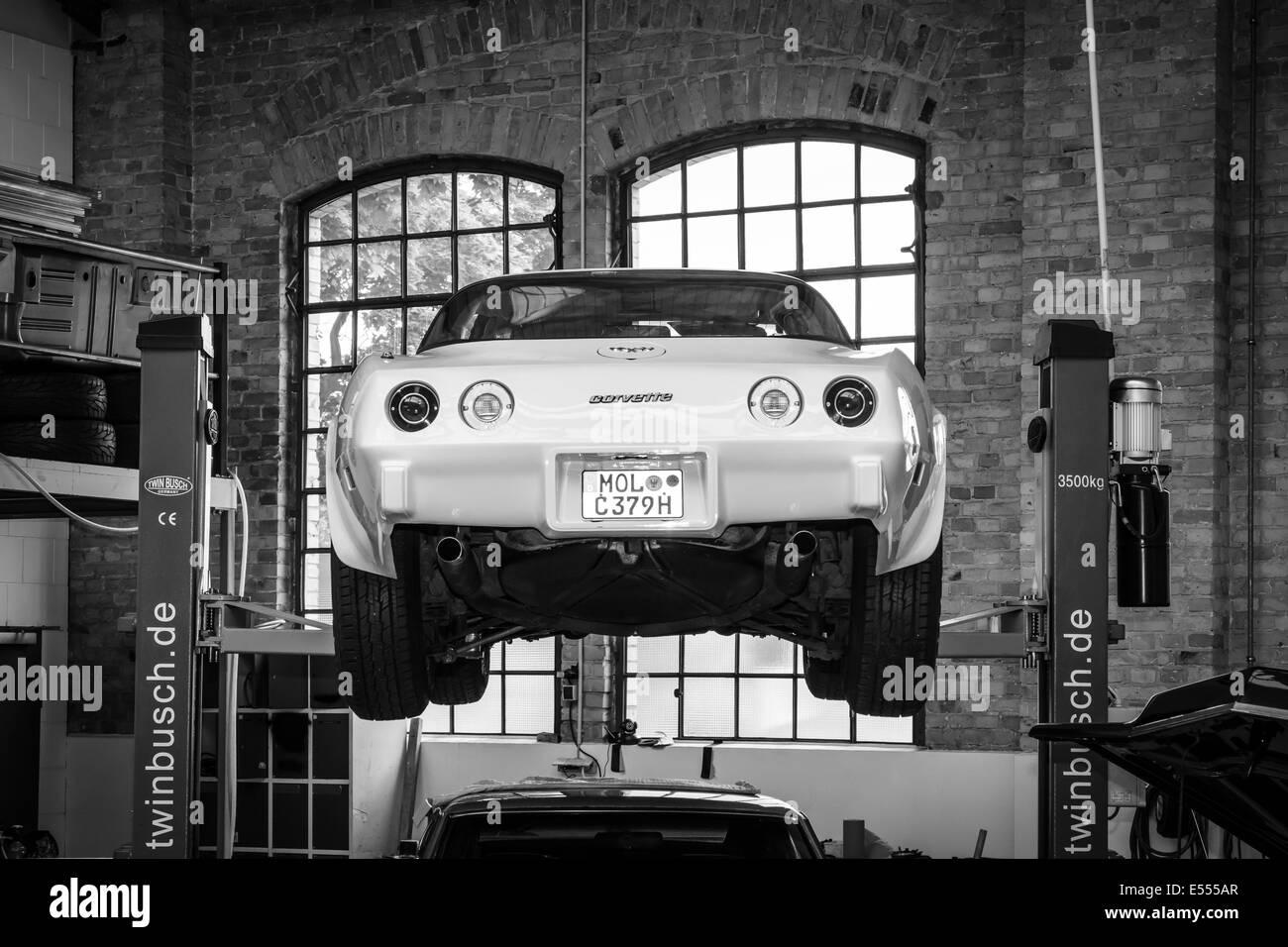 Modern Chevrolet Corvette in the workshop. Black and white. 27th ...