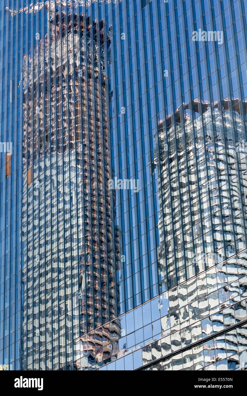 reflection-of-two-buildings-on-a-glass-b