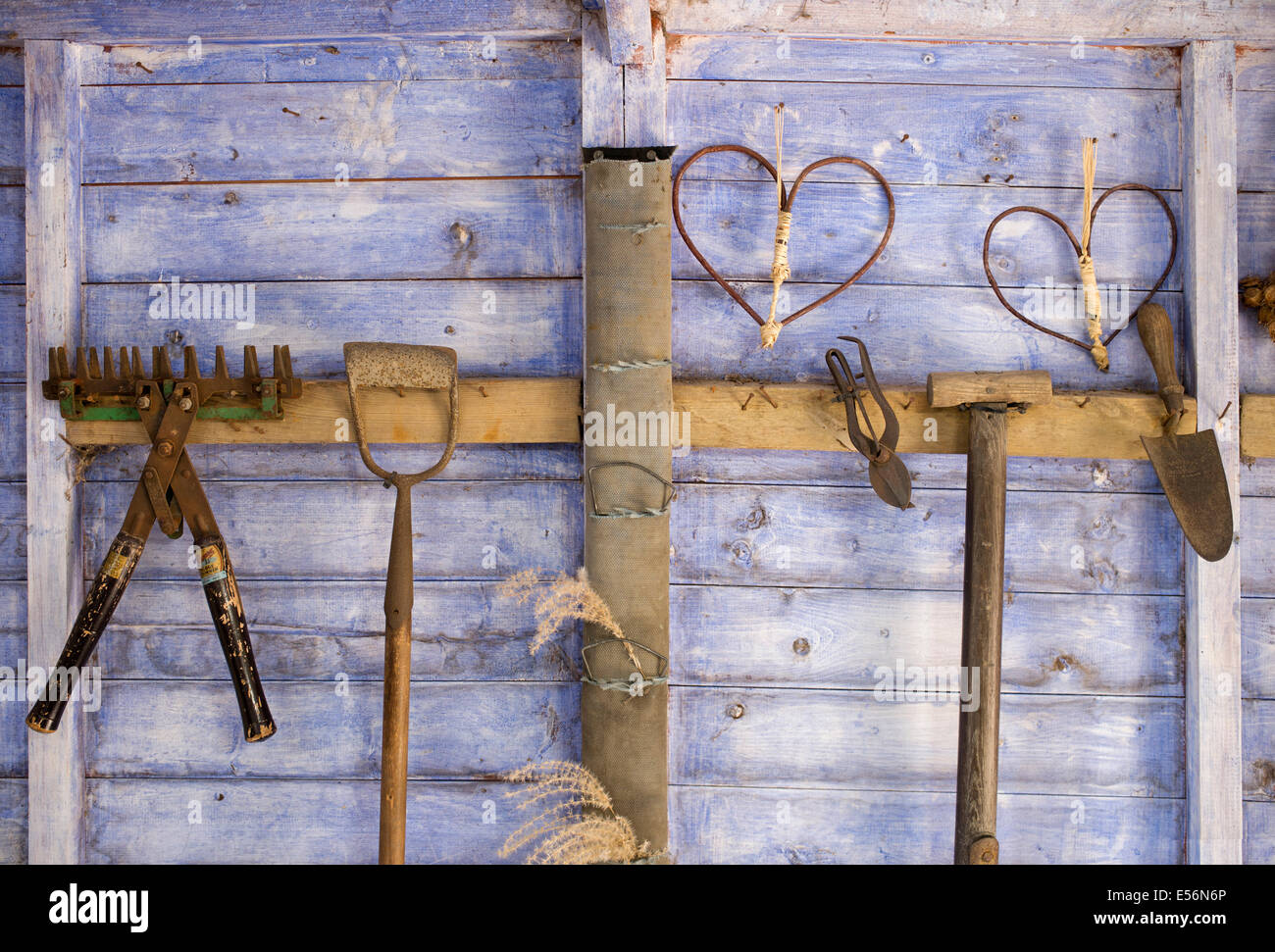 Stick heart shapes and old garden tools inside the for Gardening tools for 6 year old
