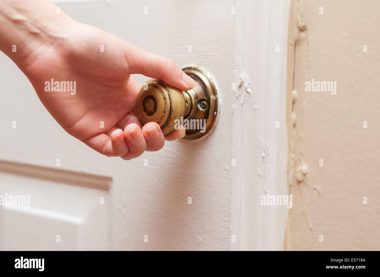 Hand opening door knob Stock Photo, Royalty Free Image: 72069434 ...