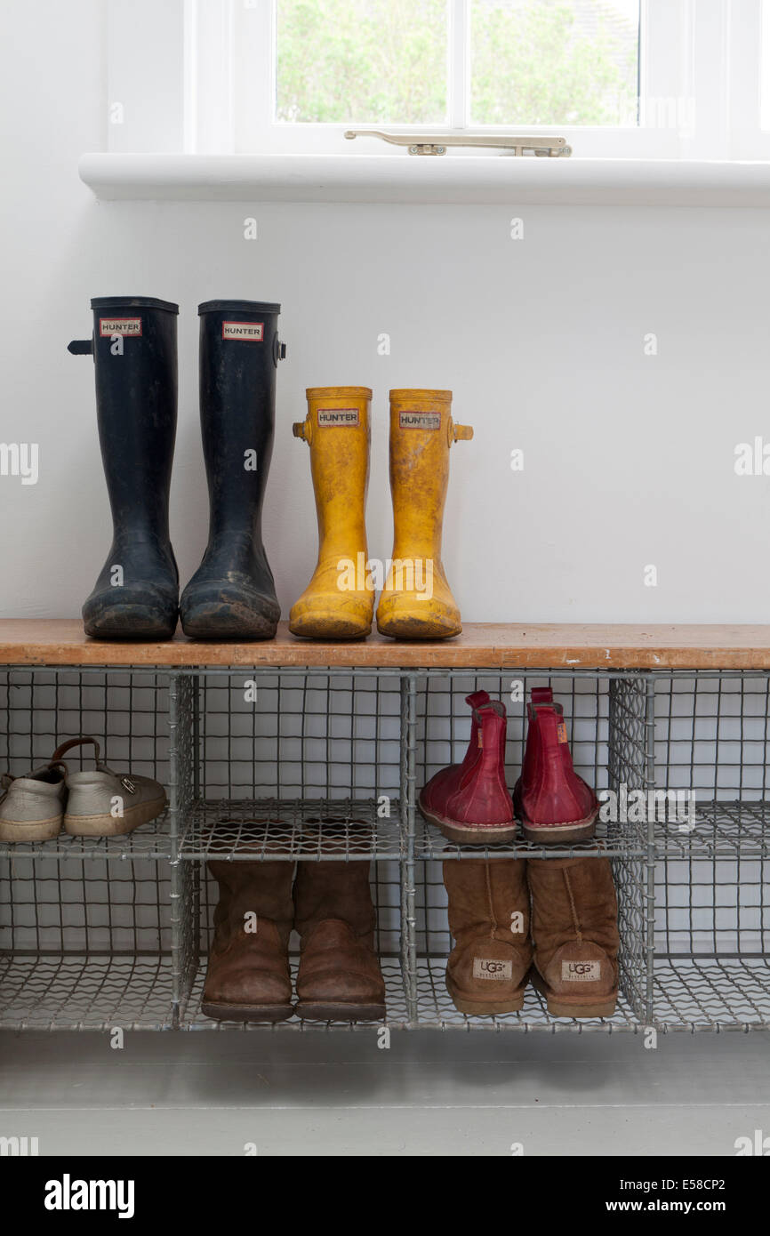 Wellington Boots In Metal Storage Shelf In Entrance Hallway In Beach House,  Sandways, Camber Sands, UK