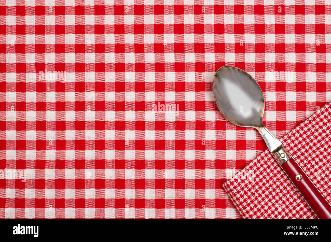 Spoon And Napkin On A Checkered Table Cloth With Red And White Checks