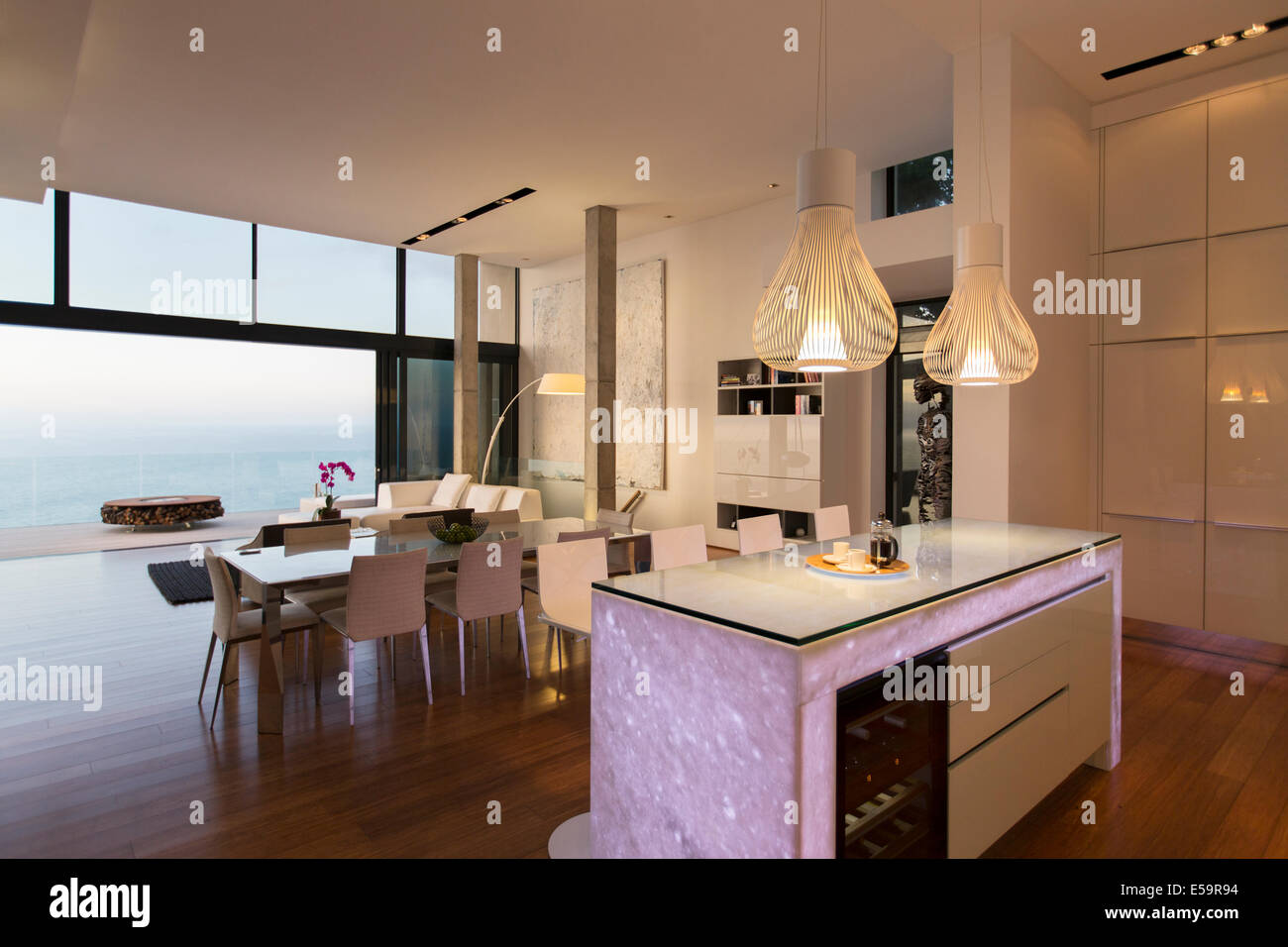 Modern Kitchen And Modern Kitchen And Living Area Overlooking Ocean Stock Photo