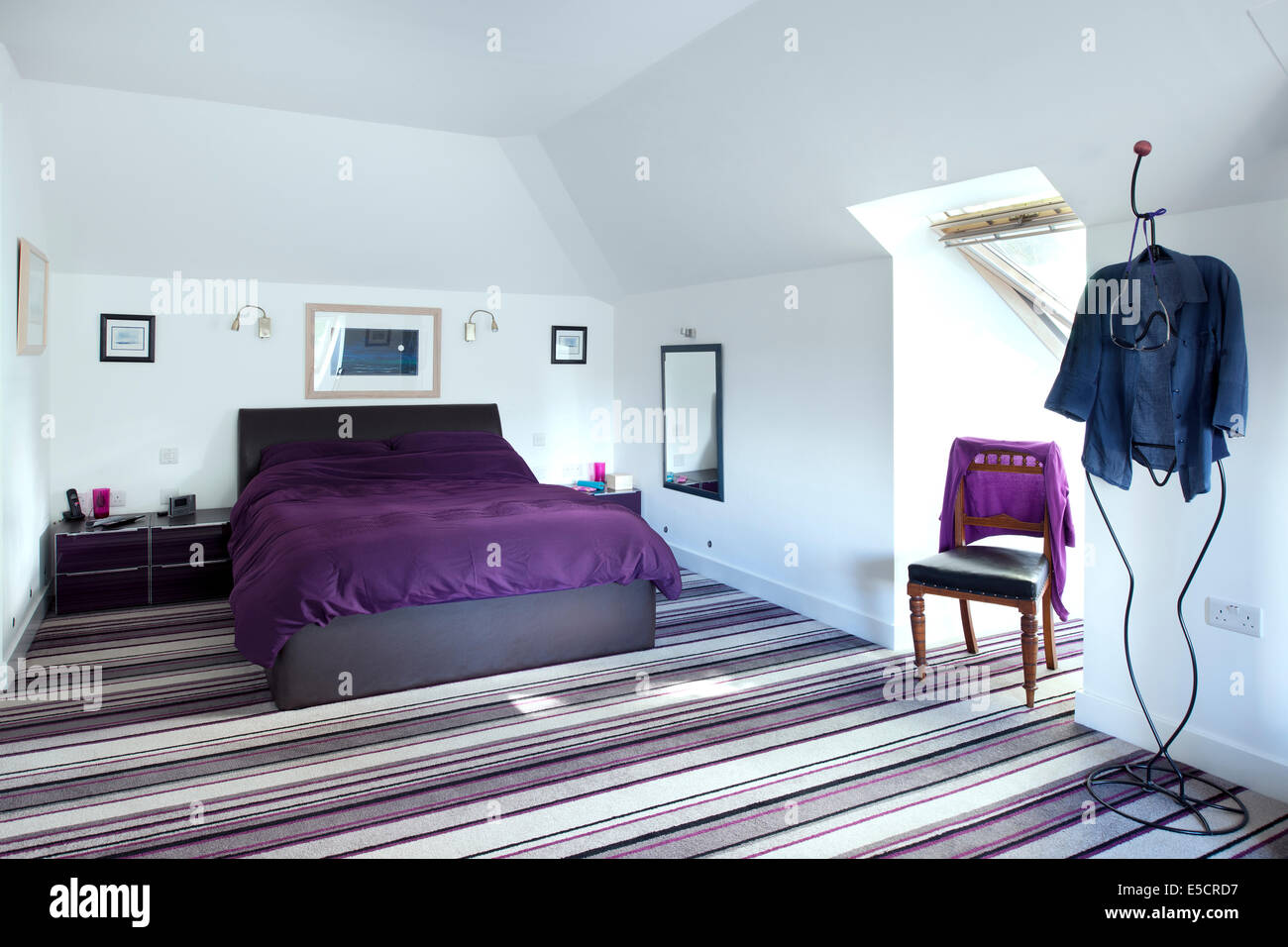 Master Bedroom With Striped Carpet In UK Home.
