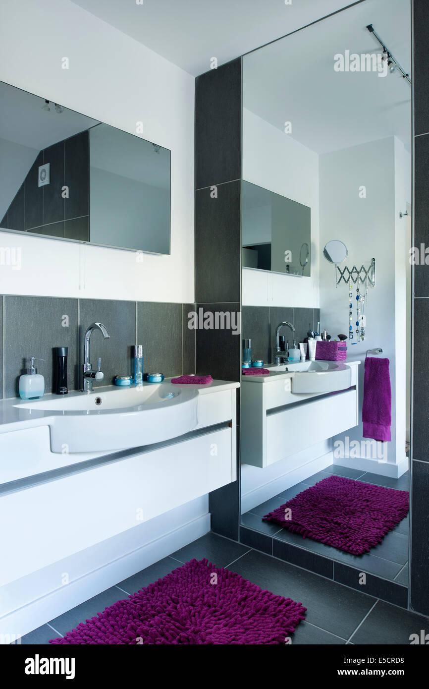 Master bedroom en suite bathroom reflected in full length mirror ...