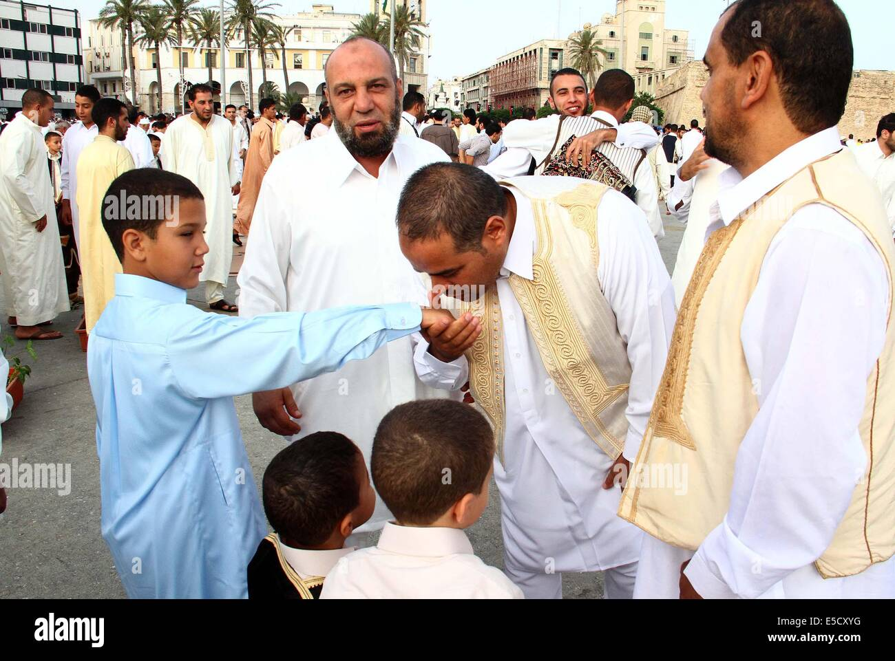 Tripoli libya 28th july 2014 people greet each other before a people greet each other before a prayer in martyrs square in tripoli libya on july 28 2014 libyan muslims prayed on monday morning to kristyandbryce Images