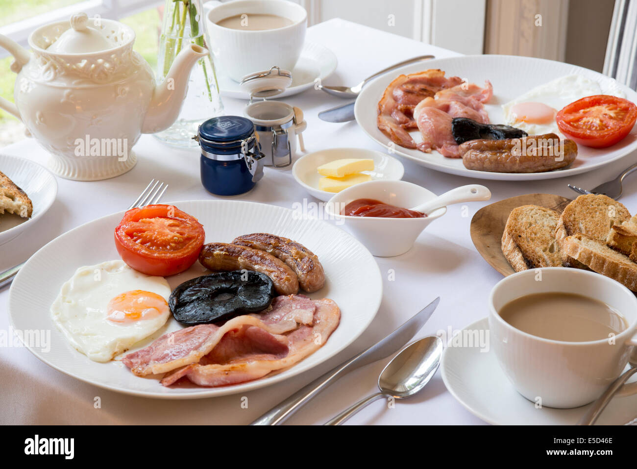 traditional english breakfast table laid out by window