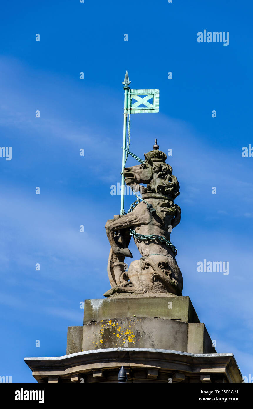 statue of a unicorn holding the scottish flag at holyrood palace