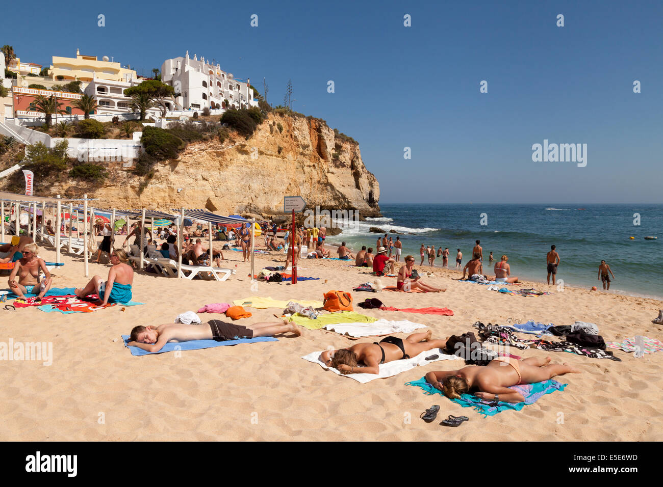 People Sunbathing On Summer Holiday Carvoeiro Beach Algarve Portugal Europe