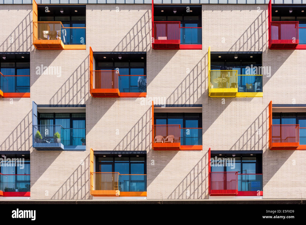 Modern Apartment Building colurful windows and small balconies of modern apartment building