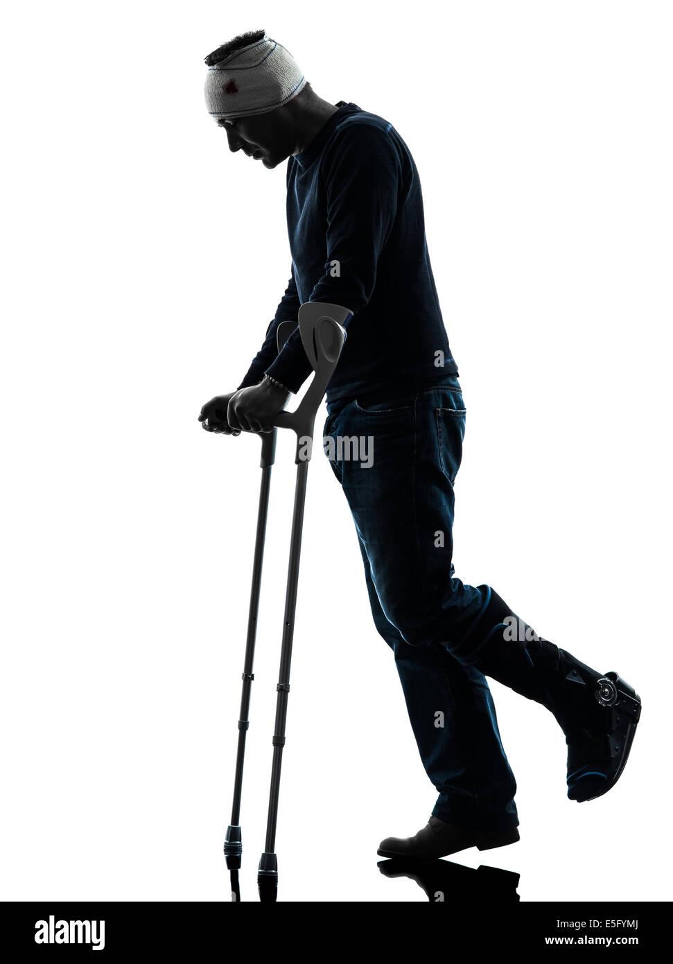 one man injured man walking sad with crutches in ...   971 x 1390 jpeg 80kB