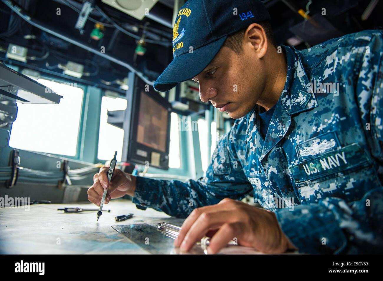 U.S. Navy Quartermaster 2nd Class Jacques Chenet, assigned to the ...