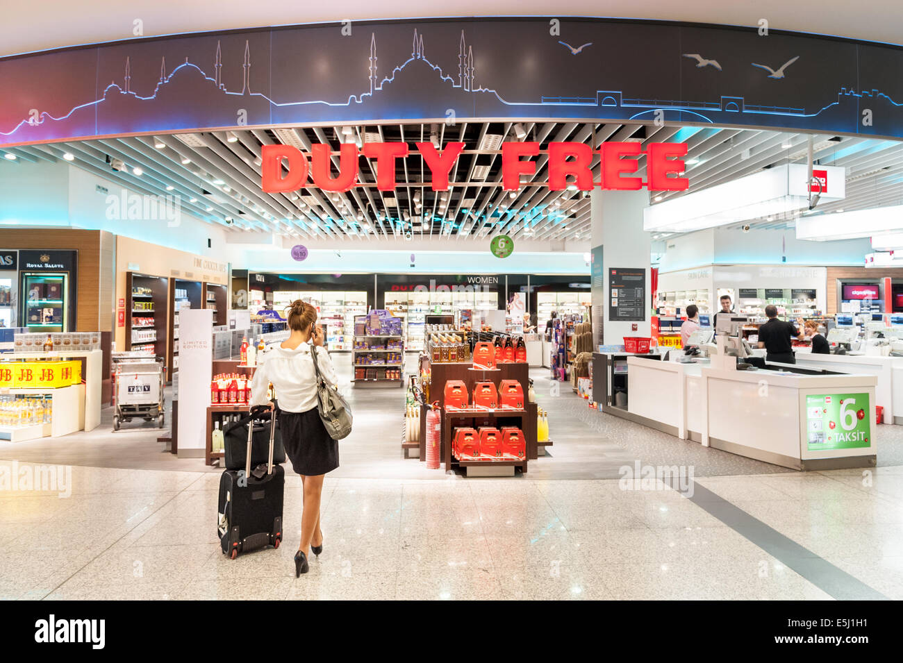 woman traveler at the duty free shop in ataturk airport terminal