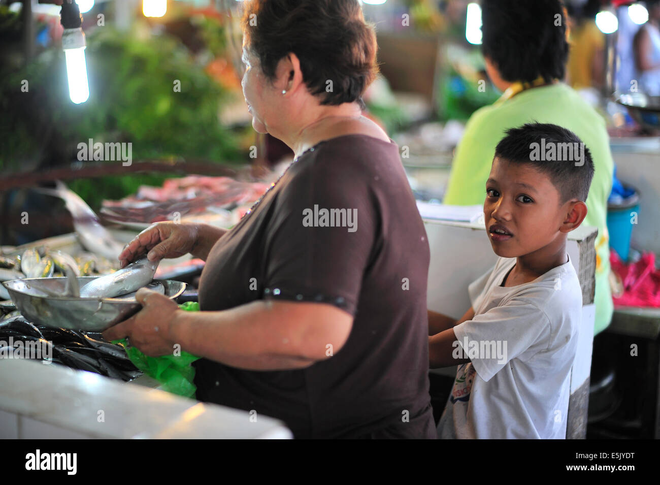 granny boy Young filipino boy helping granny in Lahug fresh food market Cebu City  Philippines