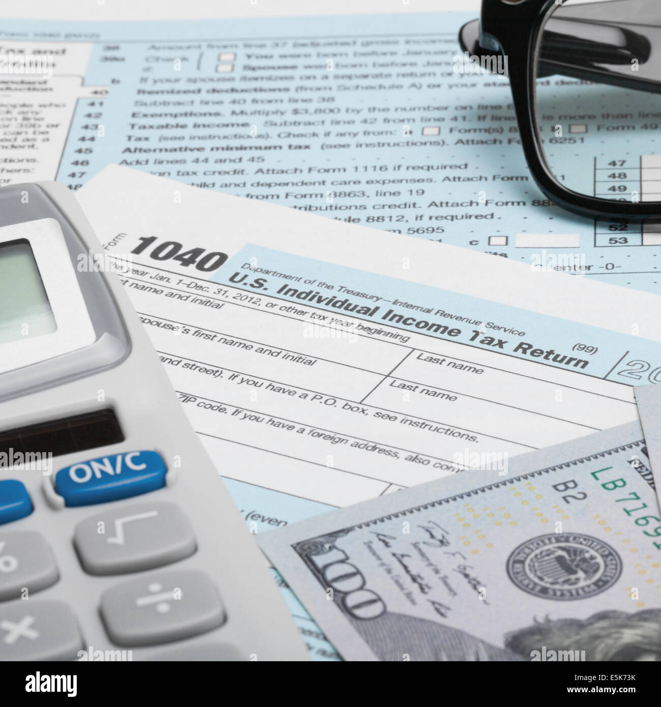 Tax form 1040 with calculator dollars and glasses 1 to for 1040 tax table calculator