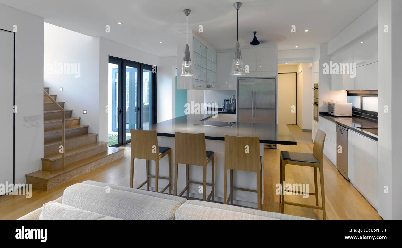 Open plan kitchen and staircase in modern house swiss for House plans with stairs in kitchen