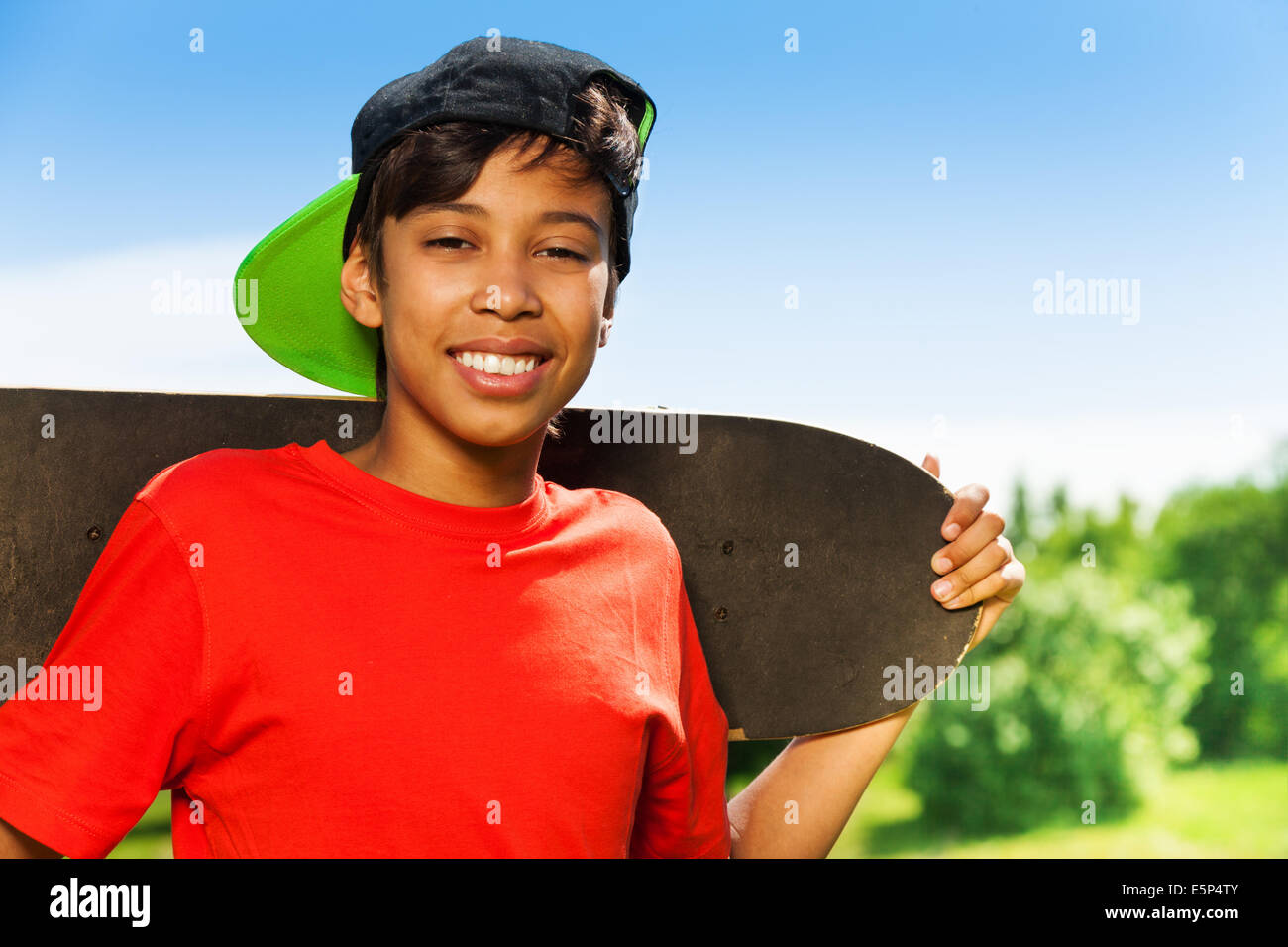 Cool boy in cap and with skateboard portrait stock photo royalty free image 72401531 alamy - Cool boys photo ...