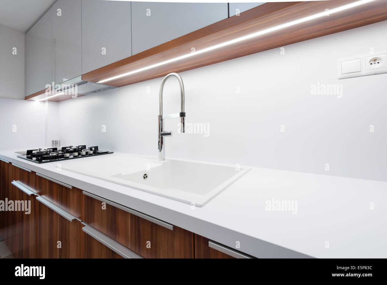 sink with tap on white worktop in contemporary kitchen. Interior Design Ideas. Home Design Ideas