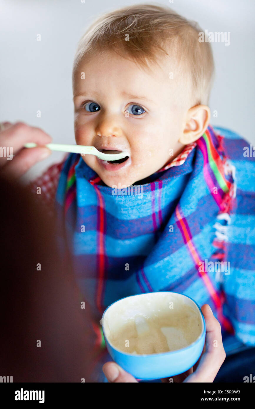 Spoon-feeding 10 month old baby Stock Photo, Royalty Free Image ...