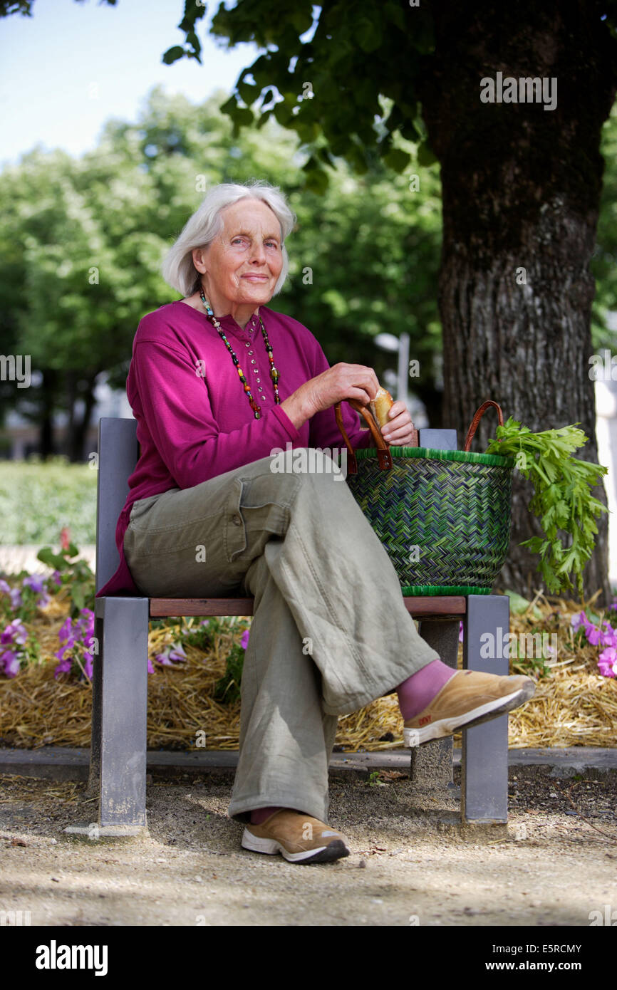 80 Year Old Woman Sitting On Bench Stock Photo Royalty